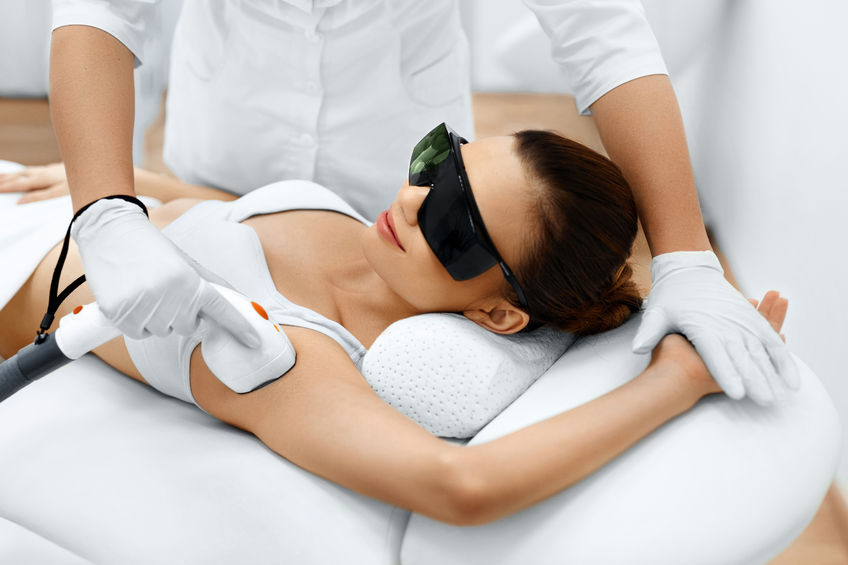 woman getting laser hair removal on armpit